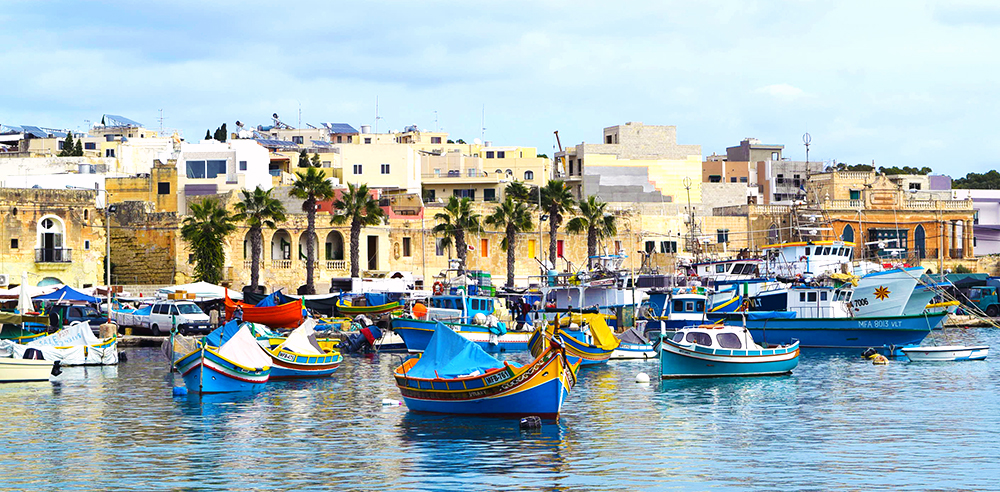 Marsasloxx Harbour with colourful boats in Malta