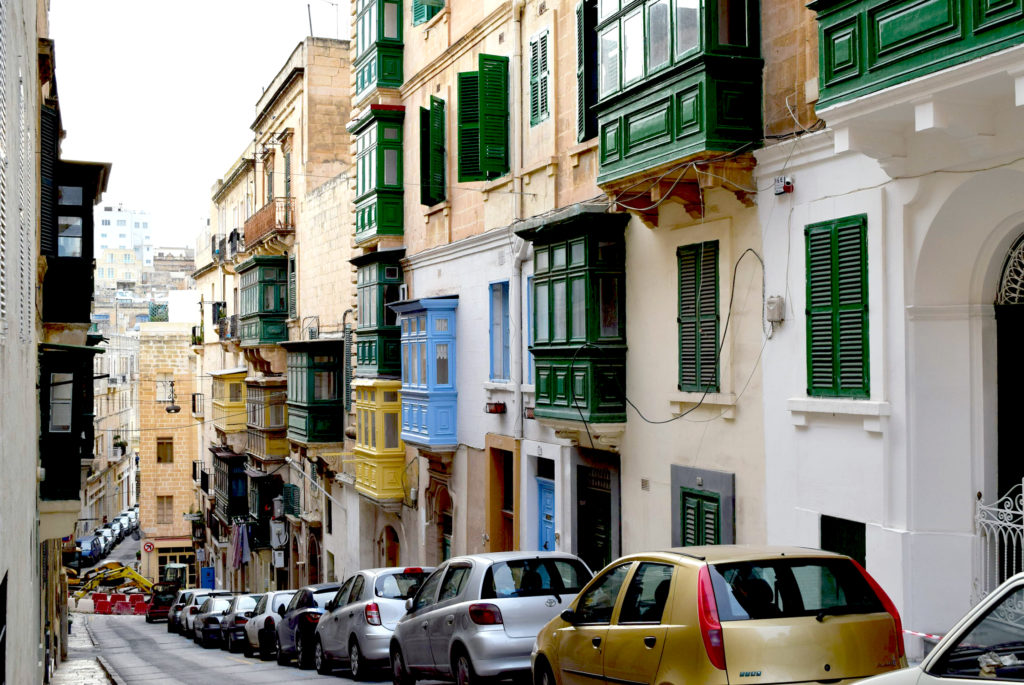Typical Street with cars and bay windows in Valletta, Malta
